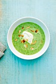 Broccoli soup with goat's cream cheese and roasted, slivered almonds