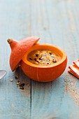 Pumpkin soup served in a hollowed out pumpkin