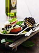 Grilled tomatoes and aubergines with mozzarella, basil and olive oil