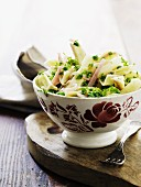 Penne pasta with Gorgonzola, peas, ham and parsley