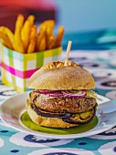 A lamb burger with aubergines and onions