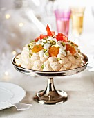 Pavlova with cream, dried fruits and pistachios