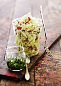 White cabbage salad in a jar with goji berries