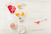 Heart-shaped cake pops being decorated