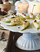 Halloumi skewers with pears and chopped almonds