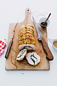 Turkey roulade filled with herbs, sliced