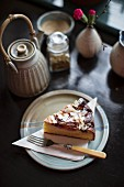 A slice of ricotta almond cake with plums