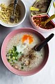 Khao tom (rice porridge with egg, Thailand)