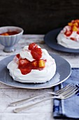 Pavlova with fruit compote