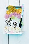 Bonbon crisps, chocolate decorations and dried fruit crisps