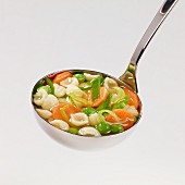 Minestrone soup in a ladle