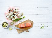 Salmon fillet, clams, chives and limes