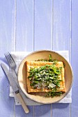 A puff pastry tart with goat's cheese and asparagus