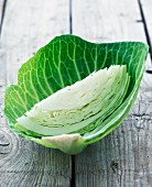 A wedge of white cabbage in a white cabbage leaf