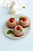 Chocolate cream cakes with raspberries