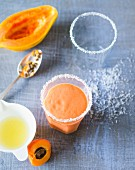 A smoothie made with papaya, lime, coconut and apricots