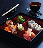 Japanese food in a square varnished box
