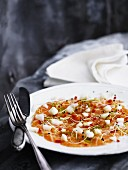Salmon carpaccio with bean sprouts, chilli, lime zest and apple