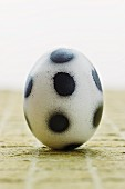 A 'football egg' – a white egg decorated with black spots