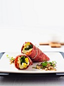 Beetroot wraps filled with goats cheese, dukkah, carrots and hard-boiled eggs