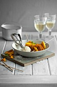 Caramelised mango skewers with lemongrass ice cream