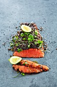 Salmon fillets with black sesame seeds, chervil and limes