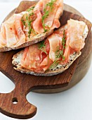 Slices of bread topped with salmon and celery