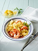 Penne with lemon sauce and prawns