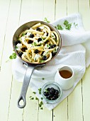 Macaroni with mozzarella and black olives