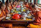 Buddhist monks eating, Battambang, Cambodia