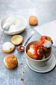Profiteroles with peach ice cream and cherry sauce