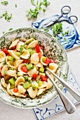 Pasta with kiwi, tomatoes and Greek basil