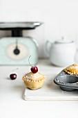 A mini cherry pie made in a muffin tin