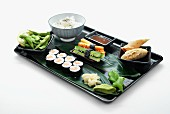 Sushi platter with rice and soy beans