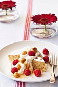 Hazelnut cake with vanilla cream and raspberries