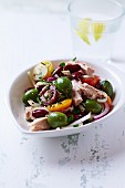 Tuna fish salad with beans, tomatoes and green olives