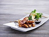 Satay skewers with soy sauce