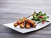 Chicken skewers with vegetables, lamb's lettuce and chilli peppers