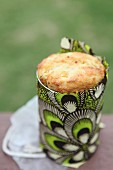 Cornbread for a picnic baked in a tin can & wrapped in colourful print fabric