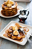Waffles with vanilla ice cream and maple syrup