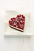A heart-shaped raspberry cake