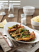 Chicken escalope with lemon and capers