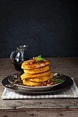 Pumpkin pancakes with honey nuts and maple syrup