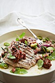 Flash fried tuna fish steak with broad beans and tomato tapenade
