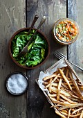 French fries with lettuce and salt