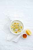 Fish soup with orange and lemon zest