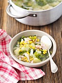 Savoy cabbage soup with ham and sweetcorn