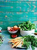 An arrangement of vegetables and herbs