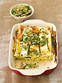Courgette and ham lasagne with almonds and parsley