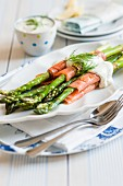 Salmon rolls with green asparagus and dill sauce